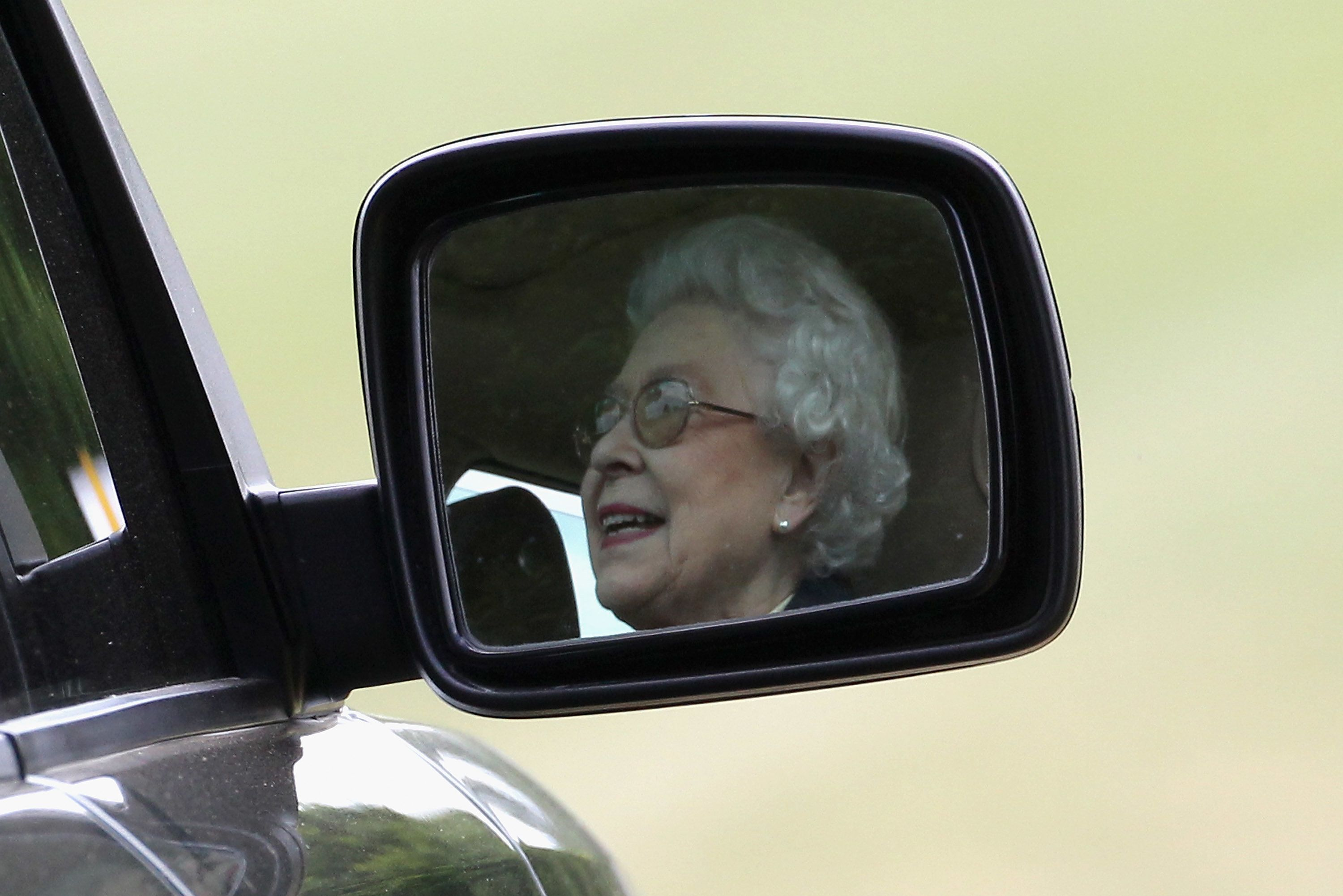 WINDSOR, ENGLAND - MAY 13:  Queen Elizabeth II drives her Range Rover as she attends Windsor Horse Show on May 12, 2011 in Windsor, England.  (Photo by Chris Jackson/Getty Images)