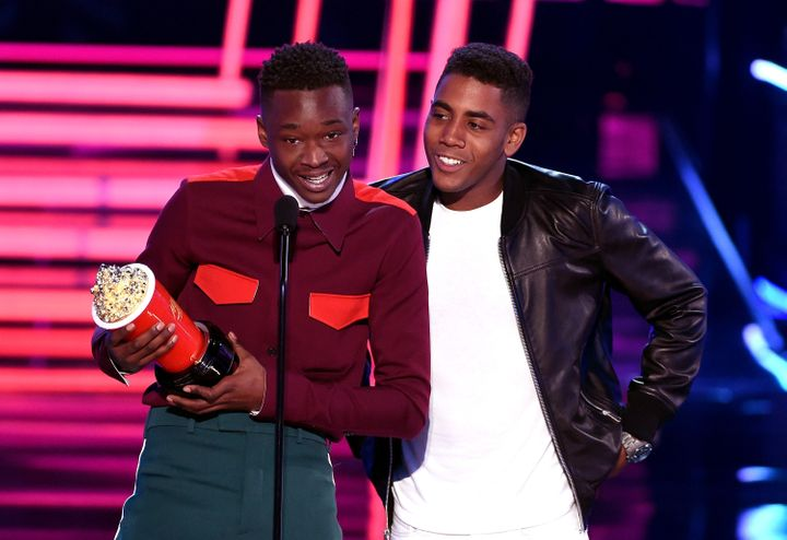"Actors Ashton Sanders and Jharrel Jerome accept the award for best kiss for ""Moonlight"" during the 2017 MTV Movie And TV Awar"