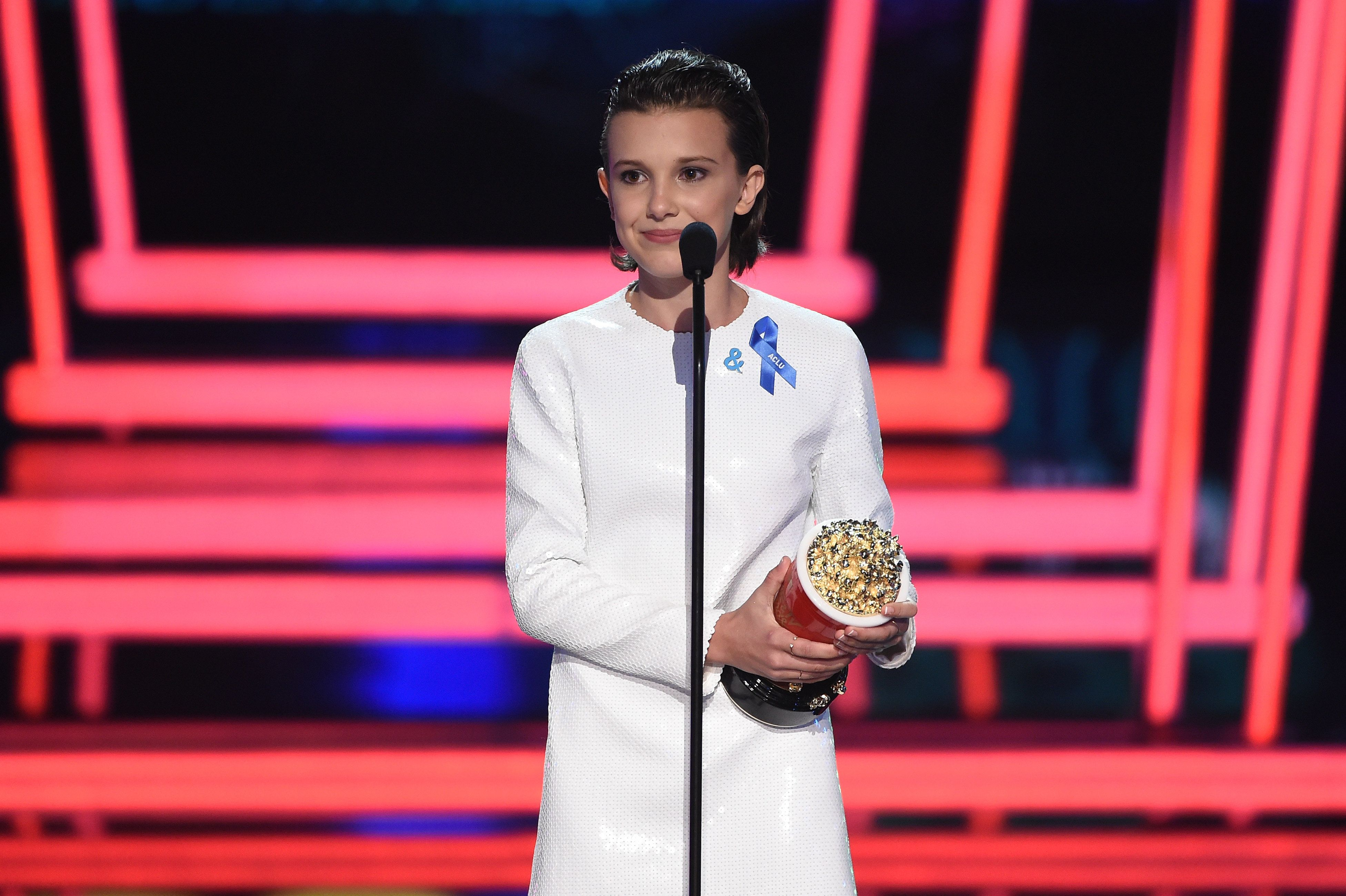 LOS ANGELES, CA - MAY 07:  Actor Millie Bobby Brown accepts Best Actor in a Show for 'Stranger Things' onstage during the 2017 MTV Movie And TV Awards at The Shrine Auditorium on May 7, 2017 in Los Angeles, California.  (Photo by Kevin Winter/Getty Images)