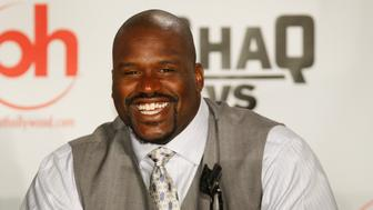 "Basketball star Shaquille O'Neal smiles as he answers a question during a ""news conference"" for the ABC television series ""Shaq vs"" at the Planet Hollywood hotel-casino in Las Vegas, Nevada August 18, 2009. Shaq will take on Oscar De La Hoya at the casino tonight. The new show will have Shaq trying to become a champion in a new sporting event every week. REUTERS/Las Vegas Sun/Steve Marcus (UNITED STATES SPORT BOXING ENTERTAINMENT)"