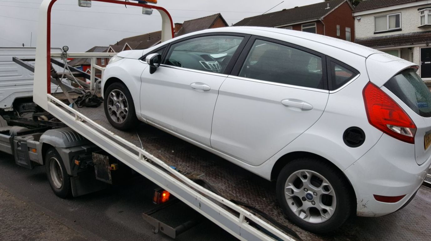 Police seized a driving instructor's car in the middle of an unsuspecting learner's driving