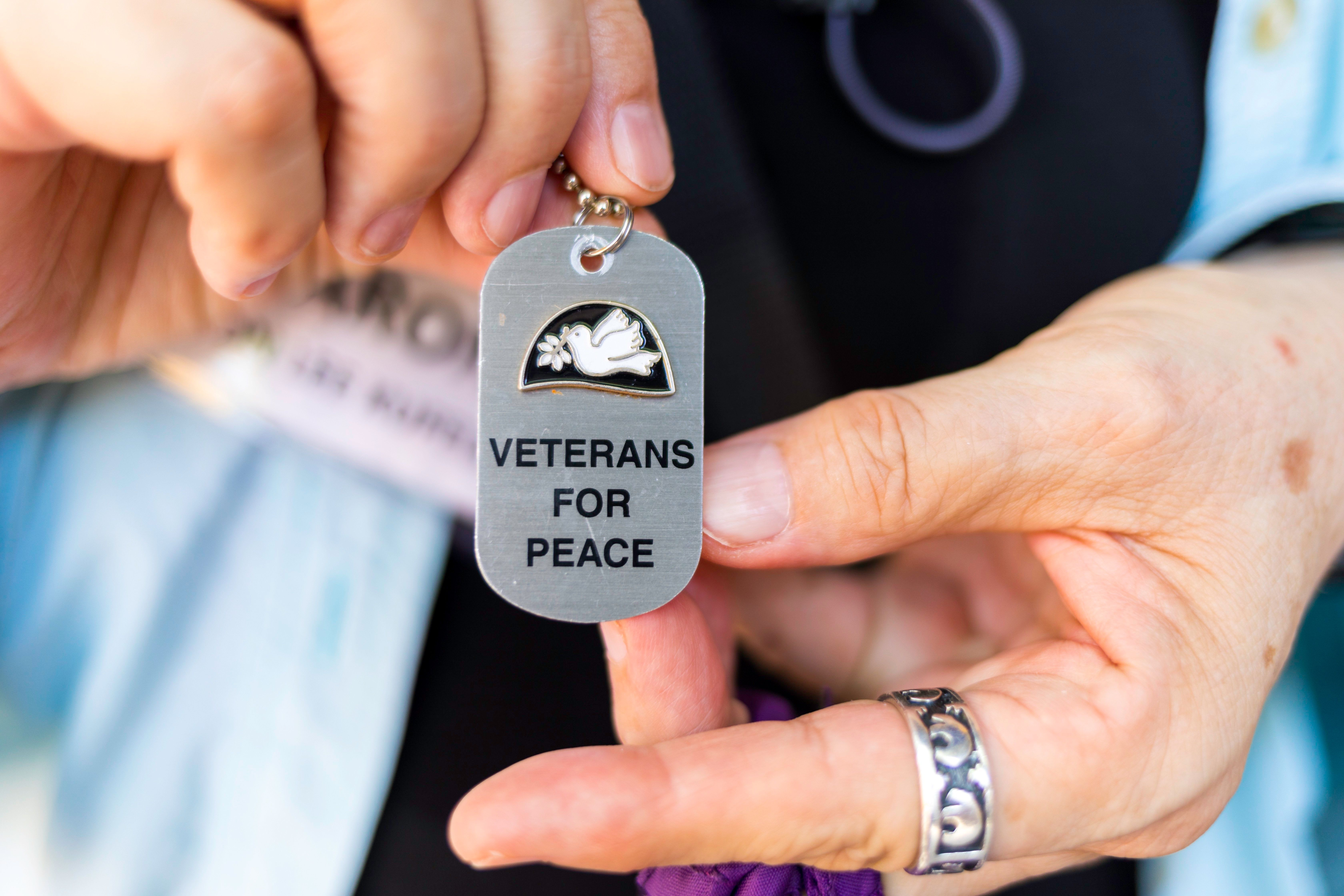 A participant on the Veterans for Peace tour of Vietnam shows a necklace she wears with the group's name on it.