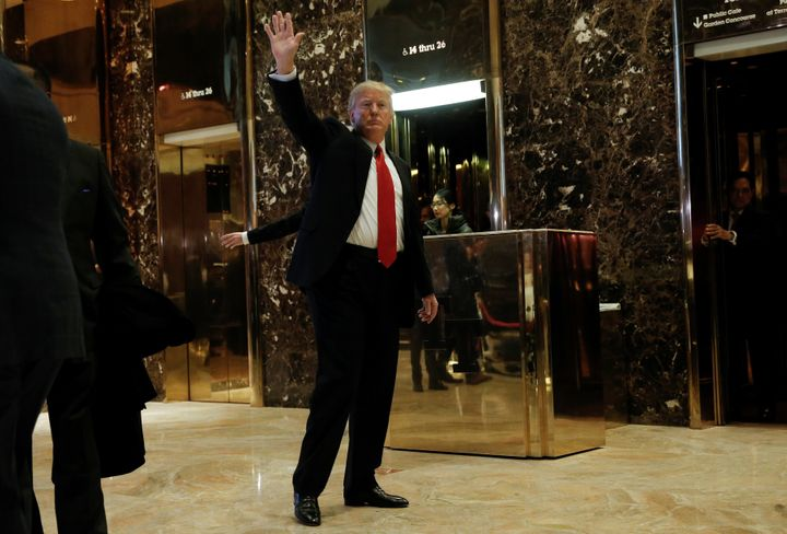 Donald Trump waves to supporters as he makes an appearance in the lobby at Trump Tower in New Yorkon Jan. 13.