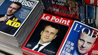 PARIS, FRANCE - MAY 08:  A rack displays French magazine front covers for 'L'Express', 'Le Point' and ''L'Obs' with the picture of the newly elected French president Emmanuel Macron a day after the second round of the French Presidential election on May 08, 2017 in Paris, France. Macron was elected President of the French Republic on May 07, 2017 with 66,1 % of the votes cast.  (Photo by Chesnot/Getty Images)