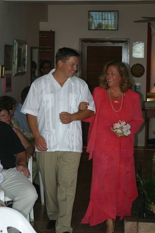 Groomsman Kevin Borland escorting Mother of the Bride Robin Corridon to her seat at the ceremony