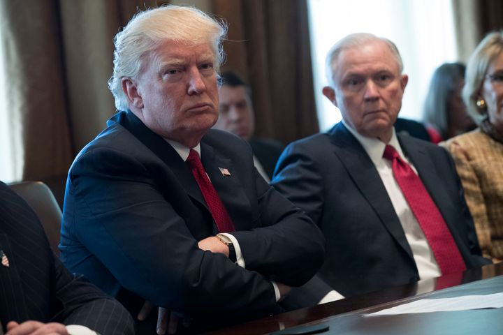 President Donald Trump and Attorney General Jeff Sessions at a White House discussion on March 29. Sessions' Justice Department has cited a ruling in a swimming pool closure case in its defense of the travel ban.