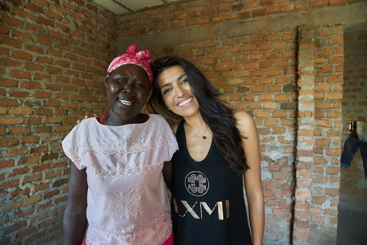 <p>LXMI founder Leilah Janah, and one of the Ugandan war widows she's employed as her harvester</p>