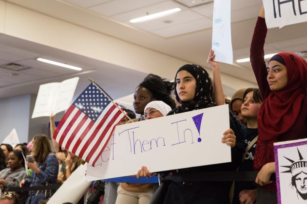 President Donald Trump's executive order on travel from Muslim-majority nations draws protests at Dallas/Fort...
