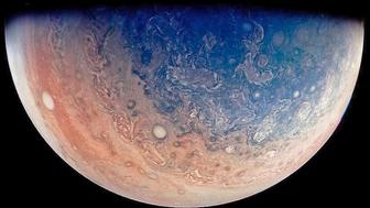 This enhanced color view of Jupiters south pole was taken on Dec 11 2016 and released by NASA on May 5 2017 The image was created by citizen scientist Gabriel Fiset using data from NASAs Juno spacecraft Numerous oval storms can be seen among the cloudscape when the picture was taken about 32000 miles above Jupiters cloud tops