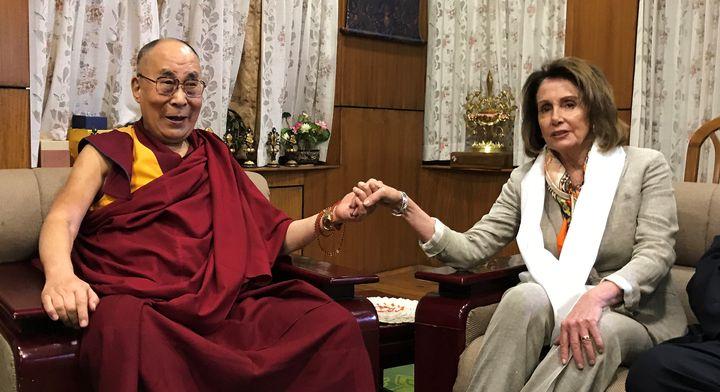 House Minority Leader Nancy Pelosi met with the Dalai Lama Tuesday at his headquarters in Dharamsala, India.
