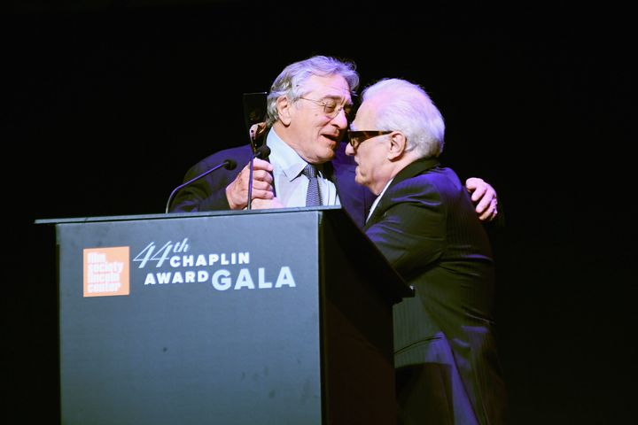 Director Martin Scorsese presents De Niro with his award.