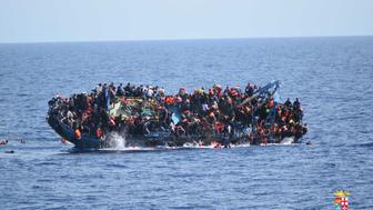 SICILIAN STRAIT, MEDITERRANEAN SEA - MAY 25: Migrants in an overcrowded boat, which was about to capsize, are rescued by Bettica and Bergamini ships of Italian Navy at Sicilian Strait, between Libya and Italy, in Mediterranean sea on May 25, 2016. The Italian Navy saved around 500 migrants as they found dead bodies of seven migrants in the sea during the operations. (Photo by Italian Navy / Marina Militare/Anadolu Agency/Getty Images)