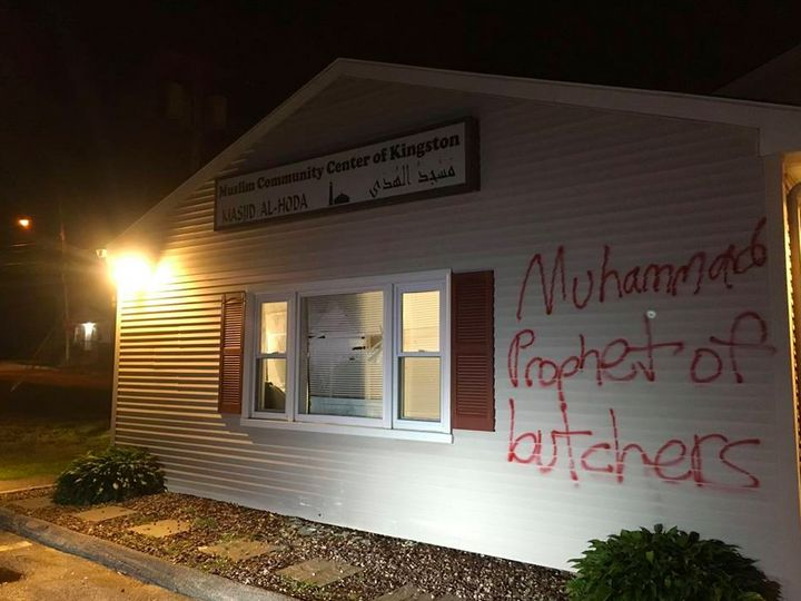 "A vandal spray-painted ""Muhammad Prophet of Butchers"" on the The Muslim Community Center of Kingston's Masj"