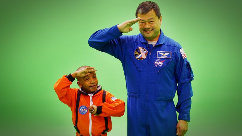 "Zayden Wright and Commander LeRoy Chiao preparing for ""blast-off"""