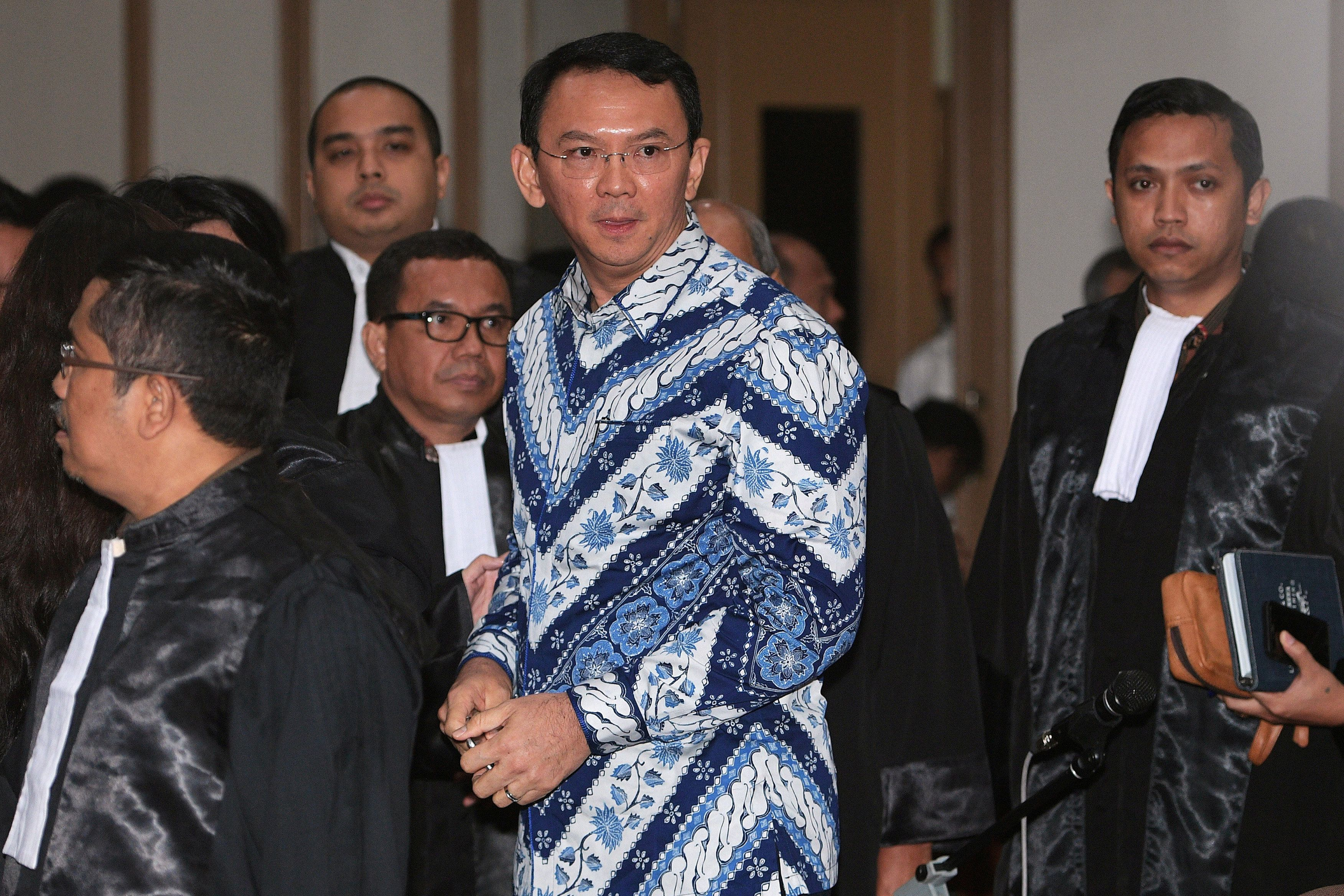 Jakarta Governor Basuki Tjahaja Purnama is seen inside a court during his trial for blasphemy in Jakarta, Indonesia May 9, 2017 in this photo taken by Antara Foto. Antara Foto/ Sigid Kurniawan/via REUTERS ATTENTION EDITORS - THIS IMAGE WAS PROVIDED BY A THIRD PARTY. FOR EDITORIAL USE ONLY. MANDATORY CREDIT. INDONESIA OUT. THIS PICTURE WAS PROCESSED BY REUTERS TO ENHANCE QUALITY. AN UNPROCESSED VERSION HAS BEEN PROVIDED SEPARATELY.  TPX IMAGES OF THE DAY