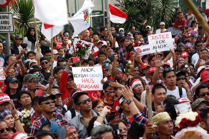 Supporters of Jakarta Governor Basuki Tjahaja Purnama, also known as Ahok, stage a protest outside Cipinang Prison, where he