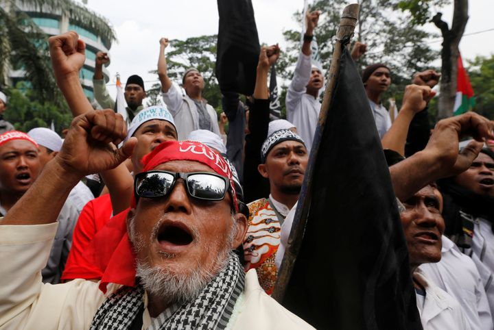 Indonesian hardline Muslims react after hearing a verdict on Jakarta's first non-Muslim and ethnic-Chinese Christian governor