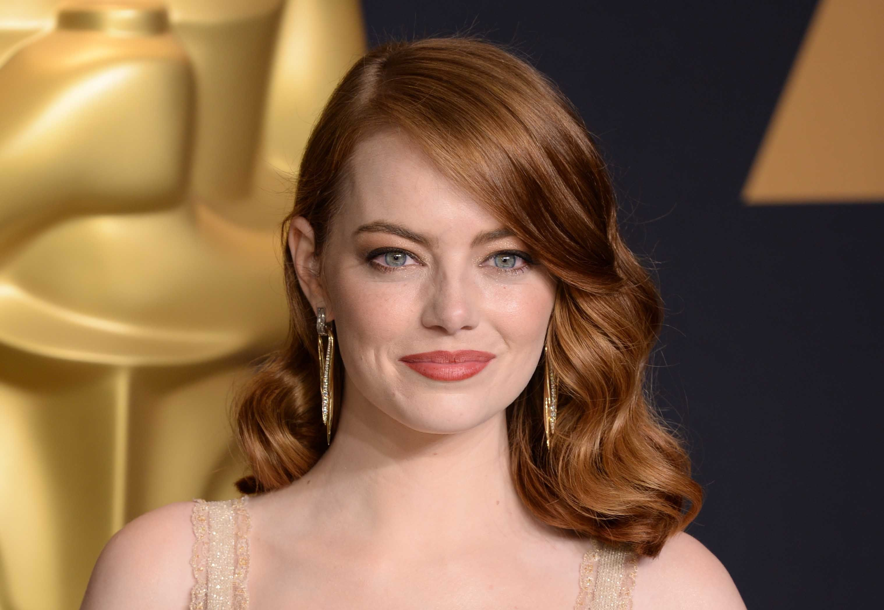 """Emma Stone with the award for Best Actress for """"La La Land."""""""