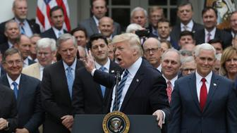 U.S. President Donald Trump (C) acknowledges House Freedom Caucus leader Rep. Mark Meadows (R-NC) (3rdL) as he gathers with Congressional Republicans in the Rose Garden of the White House after the House of Representatives approved the American Healthcare Act, to repeal major parts of Obamacare and replace it with the Republican healthcare plan, in Washington, U.S., May 4, 2017. REUTERS/Carlos Barria