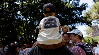 SYDNEY, NEW SOUTH WALES - JANUARY 21:  A young child attends an anti-U.S. President Donald Trump gathering on January 21, 2017 in Sydney, Australia. The marches in Australia were organised to show solidarity with those marching on Washington DC and around the world in defense of women's rights and human rights.  (Photo by Brook Mitchell/Getty Images)