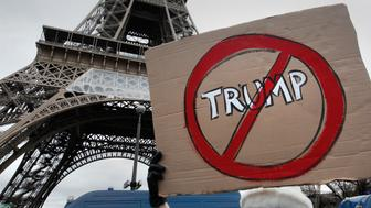 Protesters rally near the Eiffel Tower to demonstrate against US President Donald Trump's immigration order in Paris, France, February 4, 2017.    REUTERS/Mal Langsdon