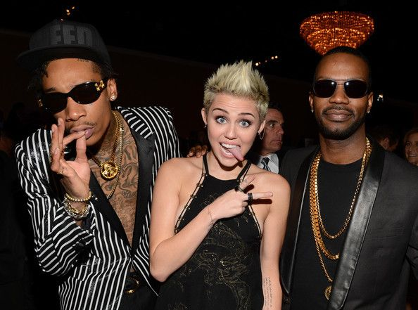 <p>Wiz Khalifa, Miley Cyrus, and Juicy J</p>
