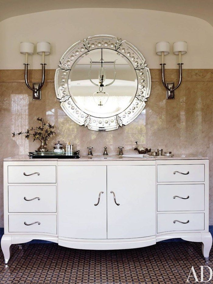 <p>In a Los Angeles master bath, a 1950s mirror from Epoca is placed above a lacquer vanity by the home's designer, Madeline Stuart.</p>