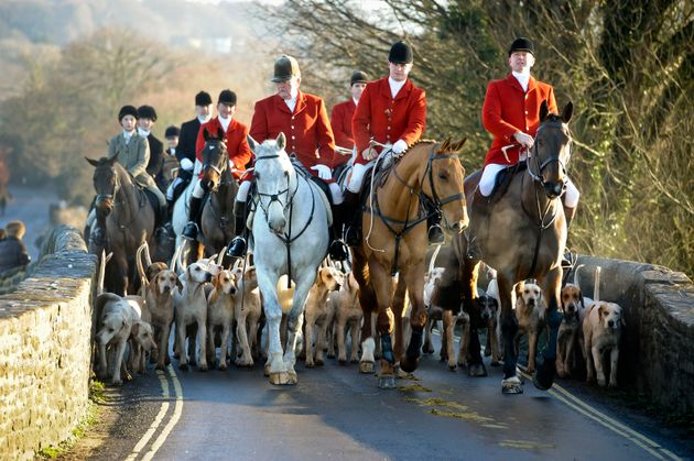The Avon Vale hunt makes its way to the village of Laycock, Wiltshire on the traditional Boxing Day