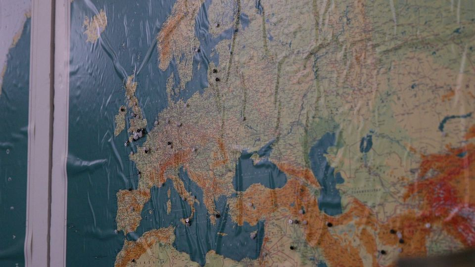 A map hung in the club shows BTTC's members come all over Europe- and