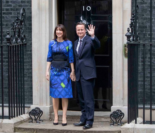 David Cameron stands on the steps of Number 10 after winning a second