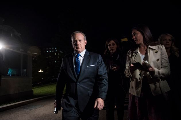 White House press secretary Sean Spicer speaks to reporters outside the West Wing after President Trump...