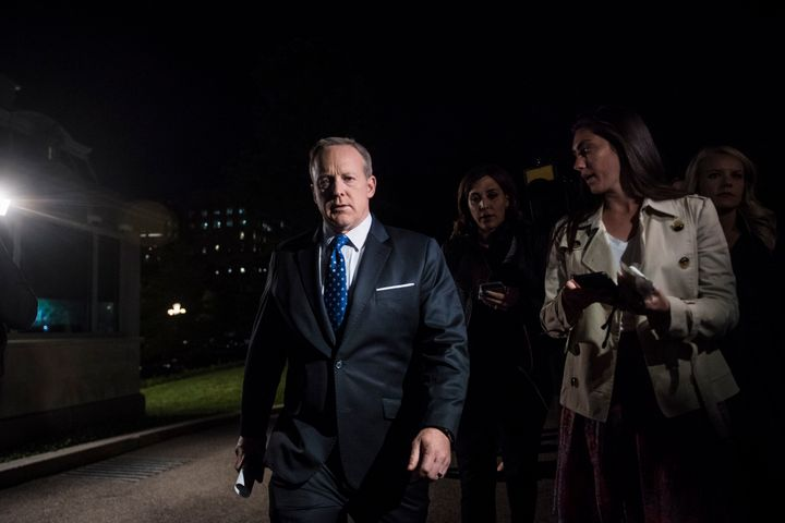 White House press secretary Sean Spicer speaks to reporters outside the West Wing after President Trump terminated FBI Director James Comey.