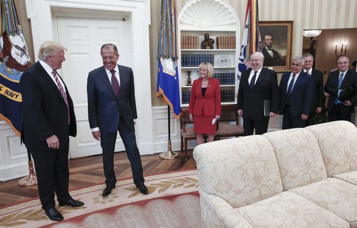 President Donald Trump and Russian Foreign Minister Sergey Lavrov (second from left) meet for talks in the Oval Office, along with Russian Ambassador Sergey Kislyak (fourth from right).