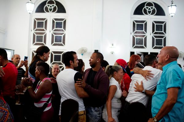People embrace each other during a mass in a church in Matanzas, Cuba, May 5, 2017.