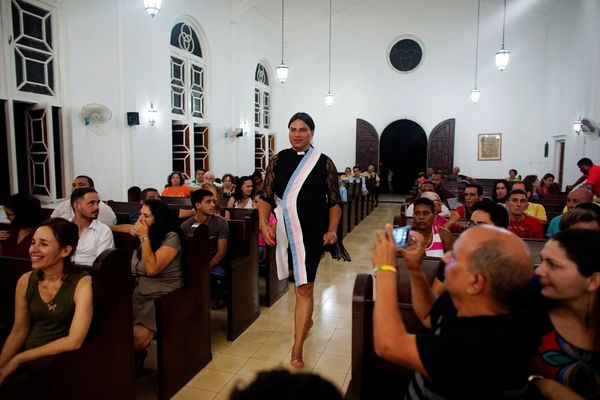 Alexya Salvador (C), a Brazilian trans pastor, walks during a mass in a church in Matanzas, Cuba, May 5, 2017.