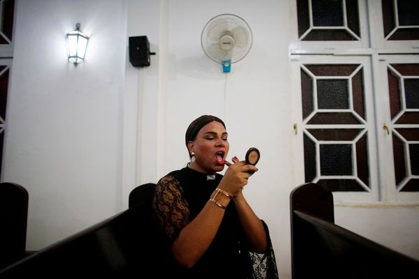Alexya Salvador, a Brazilian trans pastor, retouches her makeup before a mass in Matanzas, Cuba, May 5, 2017.