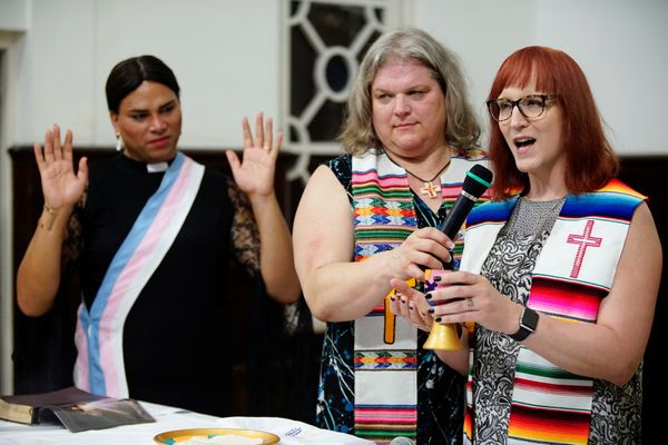 Trans pastors Cindy Bourgeois from Canada (C) and Alexya Salvador from Brazil listen to trans Baptist reverend Allyson Robins
