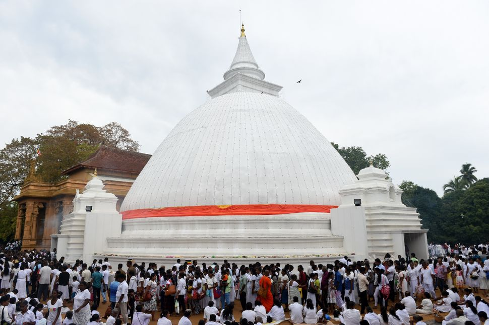 Sri Lankan Buddhist devotees offer prayers at the Kelaniya Temple during the Vesak Festival in the Colombo suburb of Kelaniya
