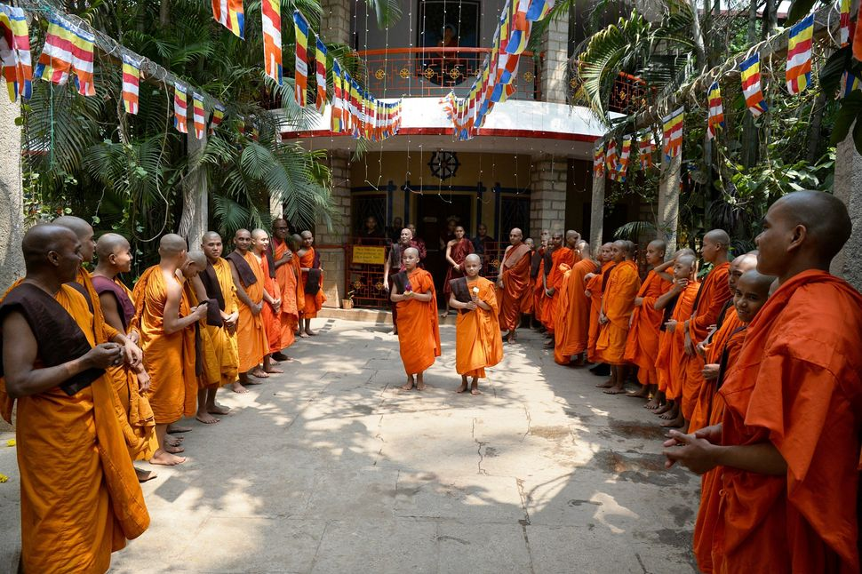 Indian Buddhist monks arrive to take part in celebrations to mark Buddha Purnima at the Maha Bodhi Society in Bangalore on Ma