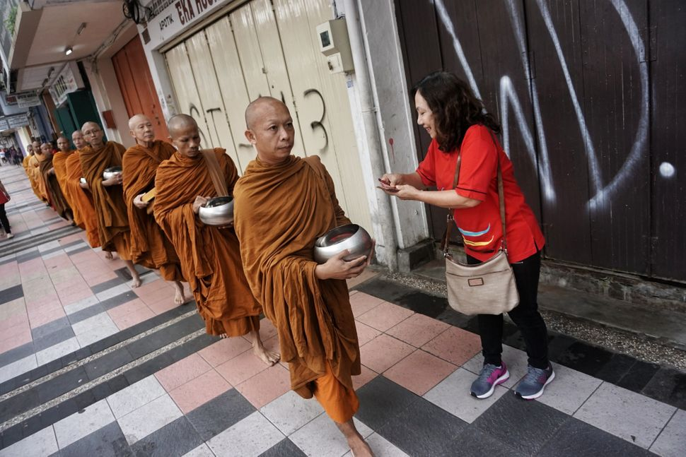 Buddhist monks walks around the street during the procession of Pindapata in Magelang, Central Java, Indonesia on May 10, 201