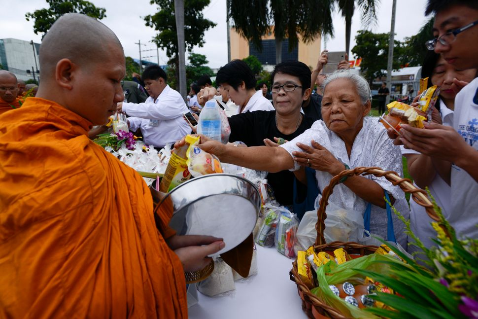 Devotees give alms to monks during a ceremony marking Visakha Bucha Day in Bangkok, Thailand, on 10 May 2017.