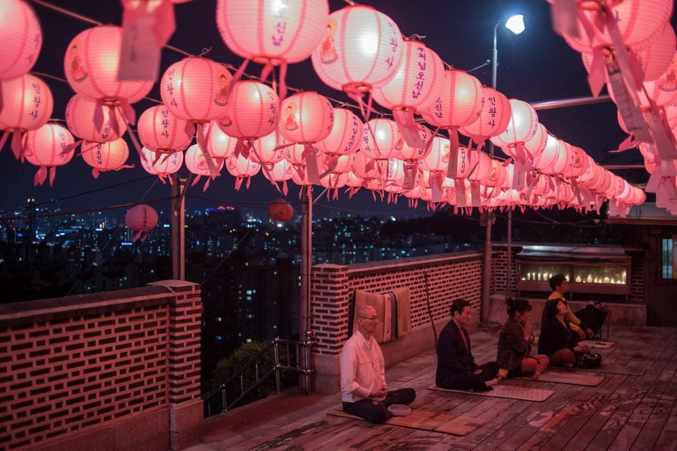 Worshippers offer prayers marking the birthday of Buddha at a shrine on a hilltop overlooking Seoul on May 3, 2017.