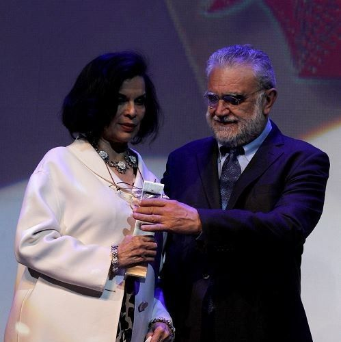 Bianca Jagger receiving the Mayahuel Award from Ivan Trujillo at the  Guadelajara International Film Festival