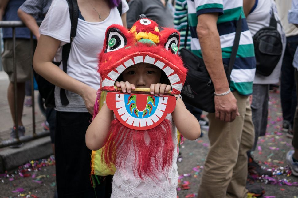 A child wearing his dragon costume during the Buddha's Birthday festival in Shau Kei Wan, Hong Kong, on May 3, 2017.