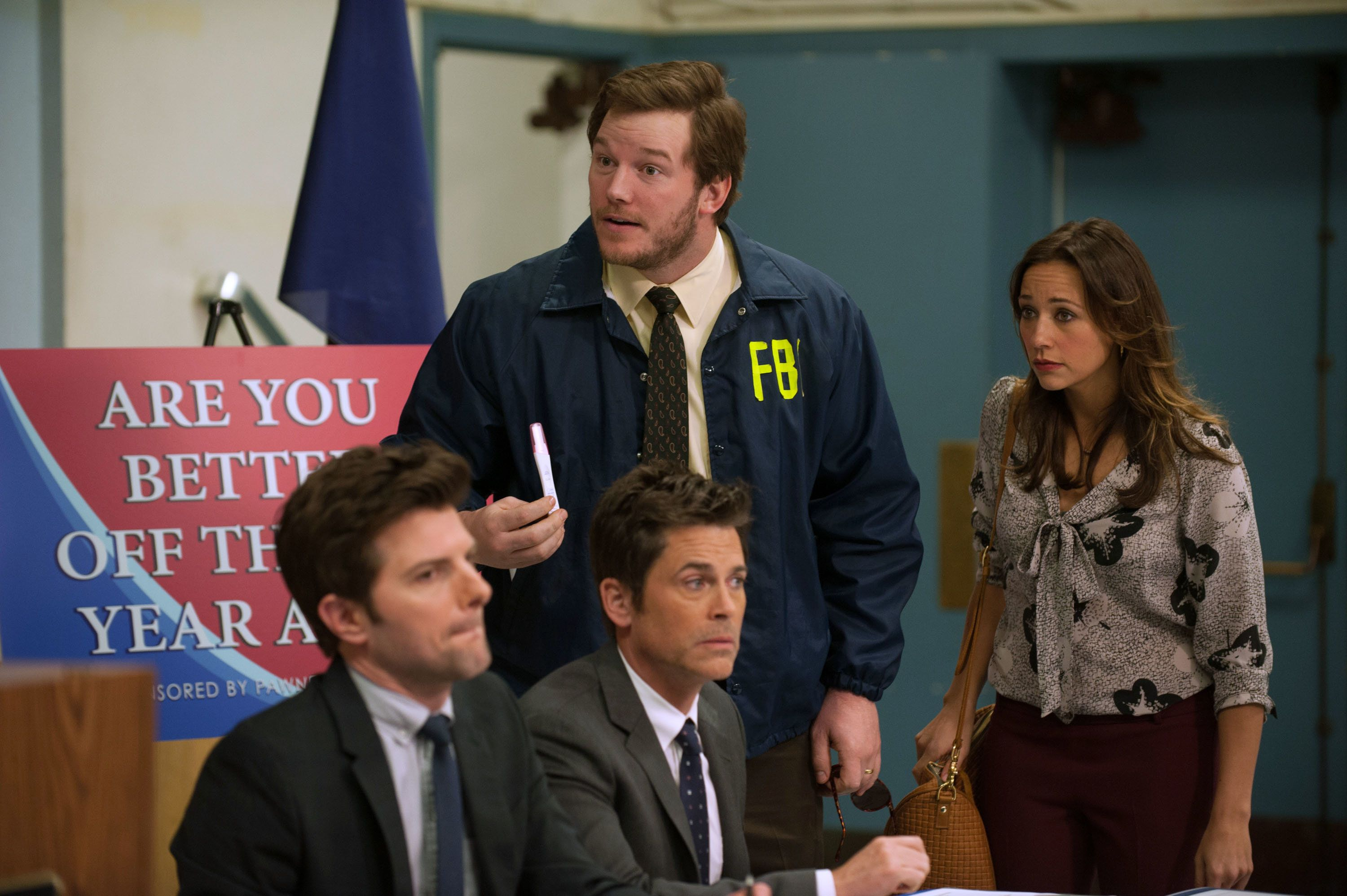 PARKS AND RECREATION -- 'Are You Better Off?' Episode 522 -- Pictured: (l-r) Adam Scott as Ben Wyatt, Rob Lowe as Chris Traeger, Chris Pratt as Andy, Rashida Jones as Ann Perkins -- (Photo by: Colleen Hayes/NBC/NBCU Photo Bank via Getty Images)
