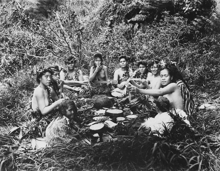 Native Hawaiians eating a meal together.