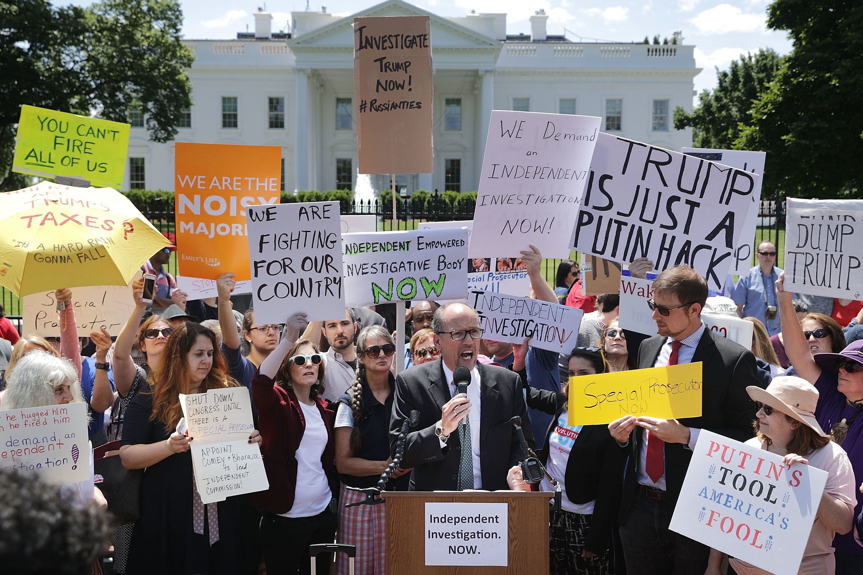 Democratic National Committee Chairman Tom Perez speaks Wednesday as people rally outside the White House to protes