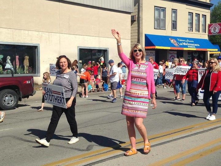Jean Stothert, at right, marches in South Omaha's annual Cinco de Mayo parade. The city's Republican mayor has cast herself a