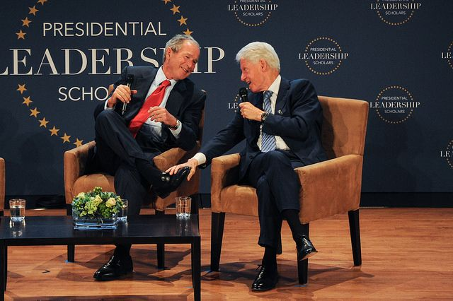 Former Presidents George W. Bush and Bill Clinton share a stage at the July 2015 graduation of the Presidential Leadership Sc