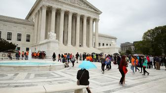 WASHINGTON, DC - APRIL 19:  People wait in line to enter the US Supreme Court, on April 19, 2017 in Washington, DC. Today the high court is hearing oral arguments from Alliance Defending Freedom in the Trinity Lutheran Church of Columbia v. Comer case about a religious preschool that was rejected from a state program that provides reimbursement grants to purchase rubberized surface material for childrenÕs playgrounds  (Photo by Mark Wilson/Getty Images)
